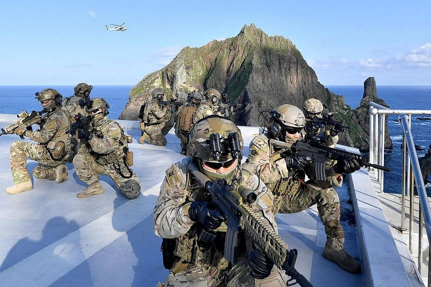 South Korean troops taking part in a military drill yesterday around disputed remote islands called Dokdo in Korean and Takeshima in Japanese.