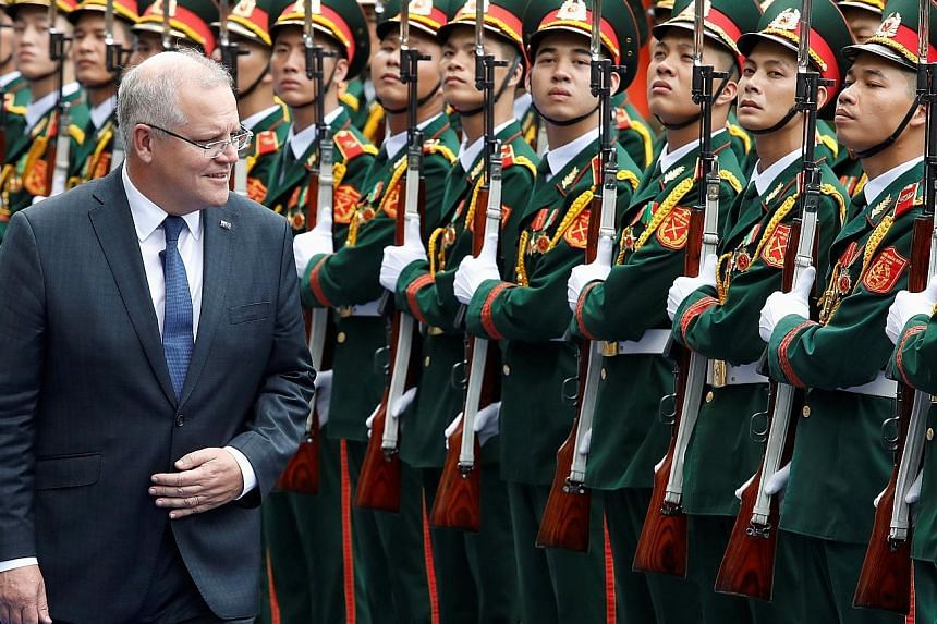 Australian Prime Minister Scott Morrison, seen here reviewing a guard of honour while in Vietnam last week, says Australia intends to prevent extremists from exploiting digital platforms to post extremely violent content. PHOTO: REUTERS