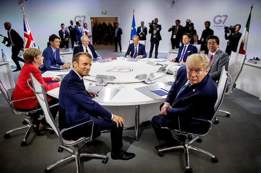 (Clockwise, from foreground left) French President Emmanuel Macron, German Chancellor Angela Merkel, Canadian Prime Minister Justin Trudeau, British Prime Minister Boris Johnson, European Council President Donald Tusk, outgoing Italian Prime Minister