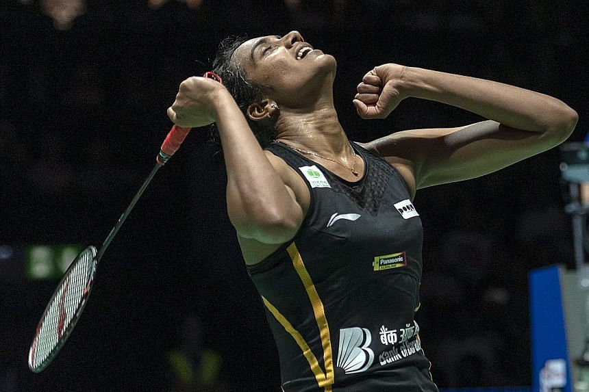 P.V. Sindhu has become the first Indian player to win gold at the BWF World Championships. She took just 36 minutes to crush third seed Nozomi Okuhara 21-7, 21-7 in Basel yesterday. PHOTO: EPA-EFE
