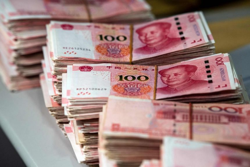 The onshore yuan fell to 7.1487 to the US dollar, its weakest point since early 2008, in Asian trading.