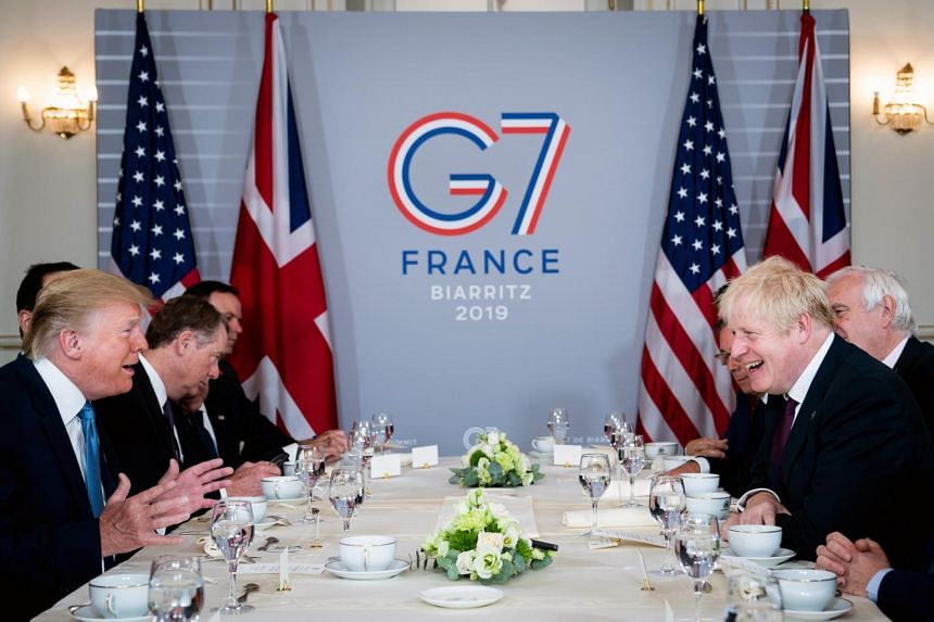 President Donald Trump shares a laugh with Prime Minister Boris Johnson of Britain during a working breakfast at the G7 summit in Biarritz, France on Aug 25, 2019.