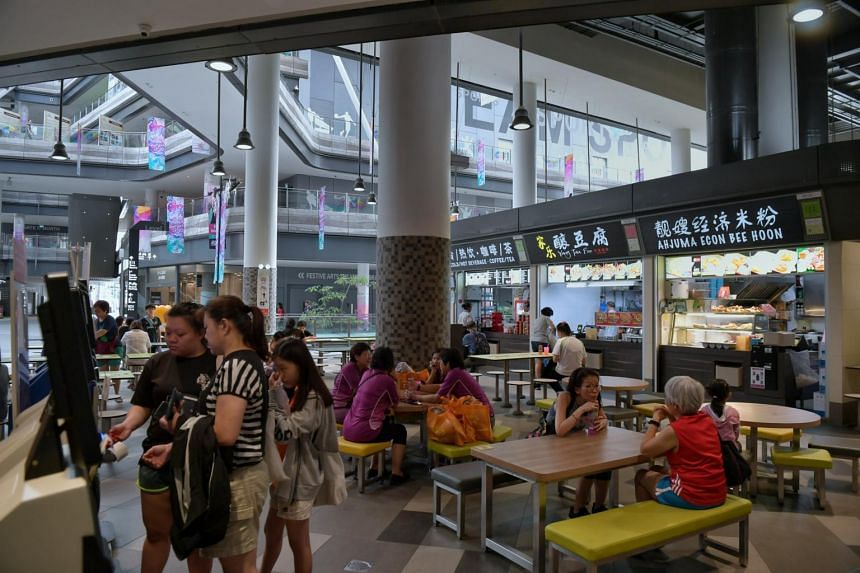 Diners at the hawker centre at Our Tampines Hub, managed by OTMH, the social enterprise subsidiary of food court operator Kopitiam.