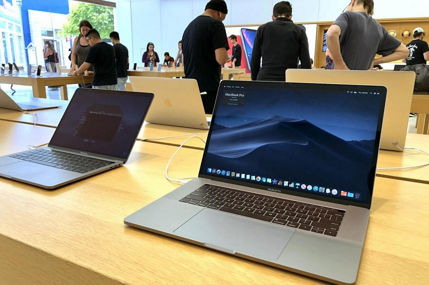 A MacBook Pro laptop is displayed at an Apple Store on June 27, 2019, in Corte Madera, California. The flight ban comes after Apple, in June, recalled some of its laptops which contain batteries that may overheat and pose a safety risk.