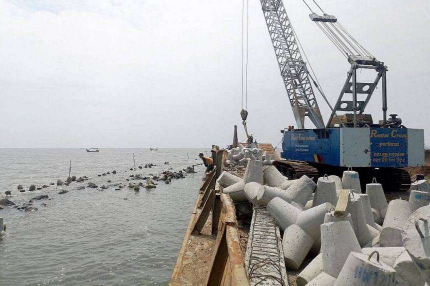 Breakwaters have been placed about 2km from North Jakarta's shores to help coastal residents, many of whom are traditional fishermen or poor families.