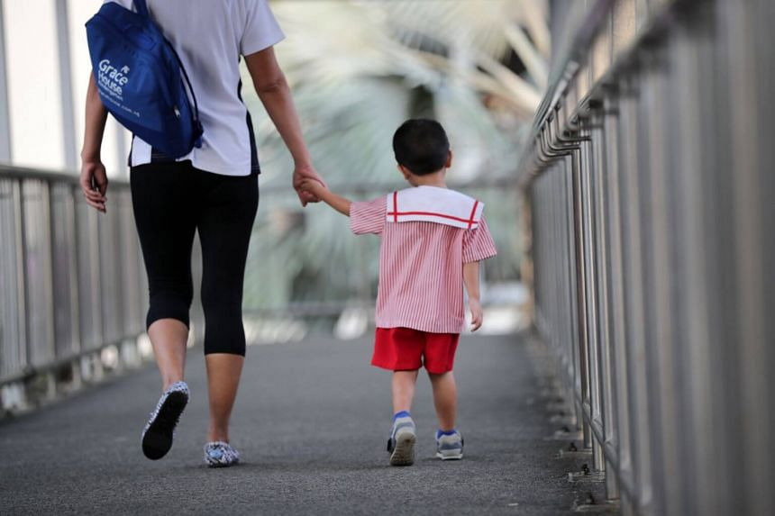 A mother and her son walking to school together.