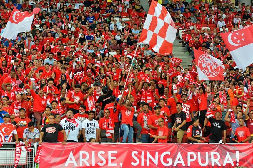 Singapore football fans showing their support for the Lions during the Singapore-Japan Group E World Cup qualifier.