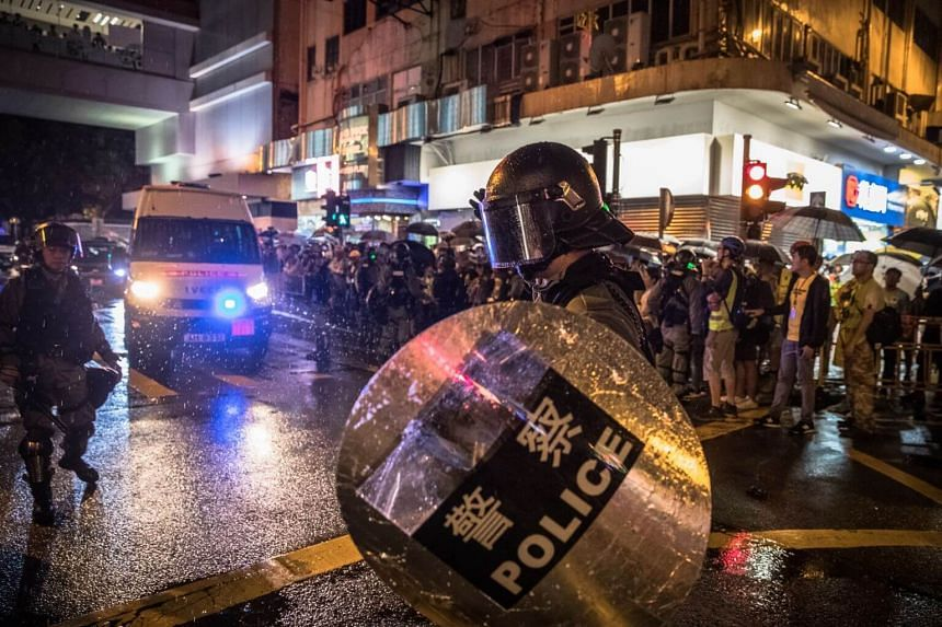 Riot police leaving after an anti-government rally in Tsuen Wan, Hong Kong, on Aug 25, 2019.
