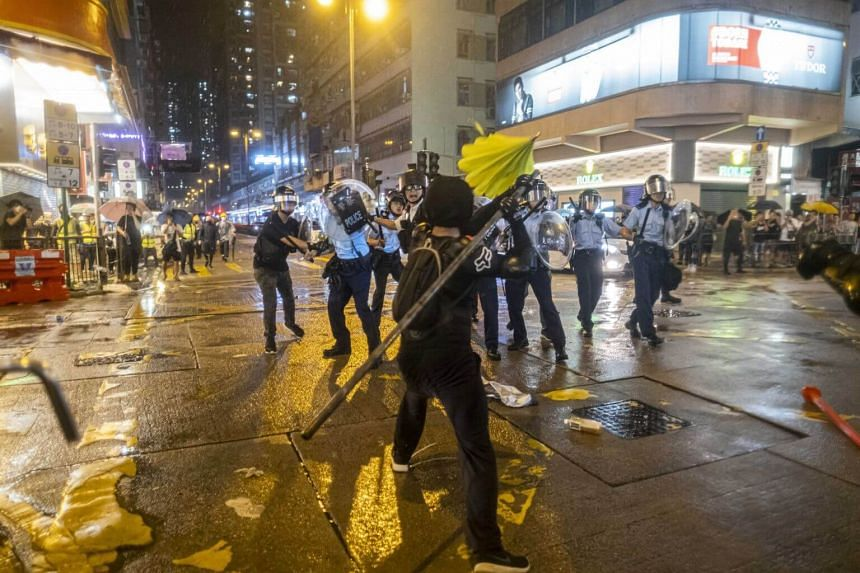 Protesters clashing with police officers in the Tsuen Wan district of Hong Kong, on Aug 25, 2019.