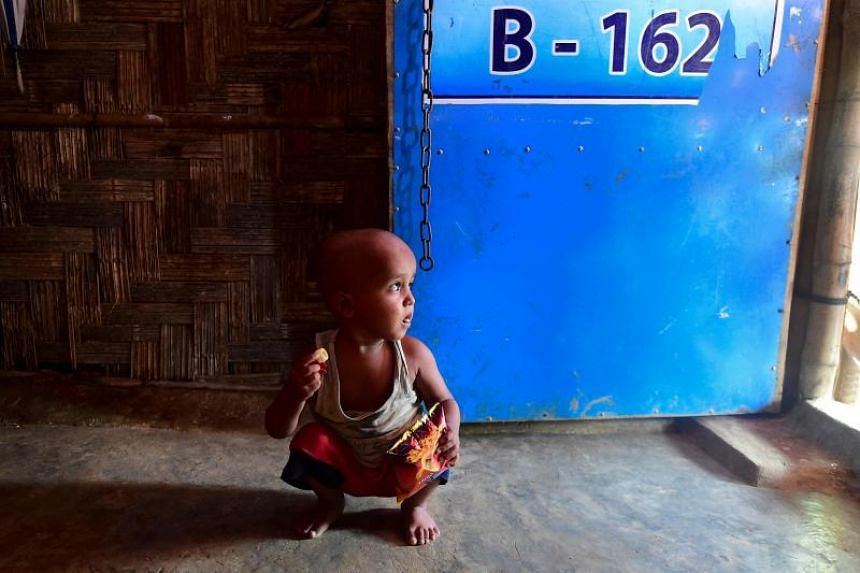Rohingya refugee Ahmad Shah looks out from a makeshift home at Balukhali refugee camp near Cox's Bazar, on Aug 25, 2019.