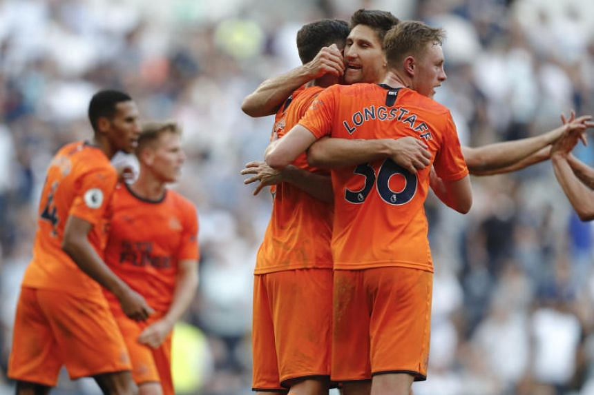 Newcastle's players celebrate at the end of the English Premier League soccer match between Tottenham Hotspur and Newcastle United at Tottenham Hotspur Stadium in London, on Aug 25, 2019.