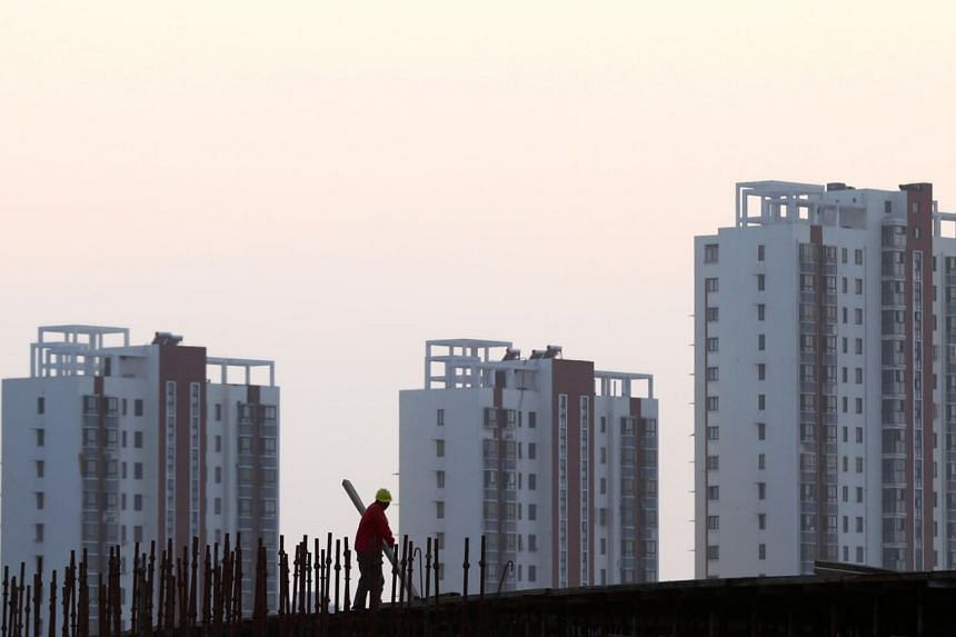 The central bank will guide local authorities to set specific lower limits on mortgage rates to reflect local real estate market conditions, the central bank said.