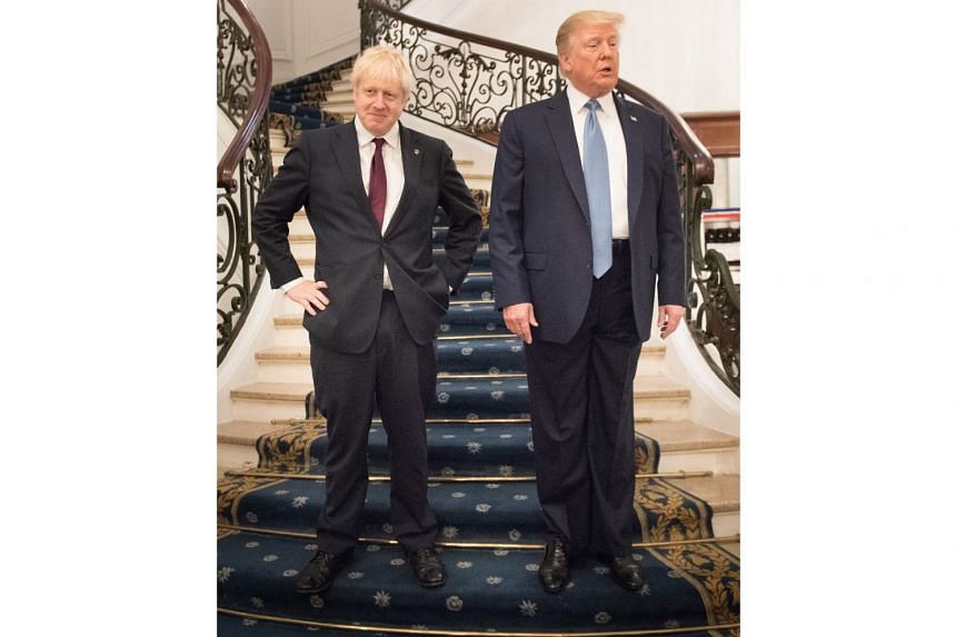 British Prime Minister Boris Johnson and US President Donald Trump before their talks at the G-7 summit in Biarritz, France, yesterday. Both appeared upbeat about the chances of success for a new US-Britain trade deal.