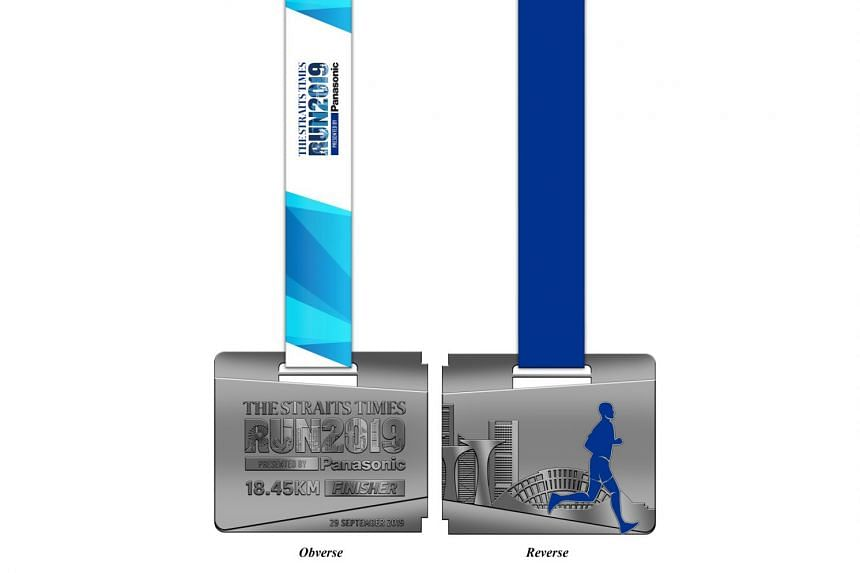 The front and back of this year's 18.45km finisher's medal.