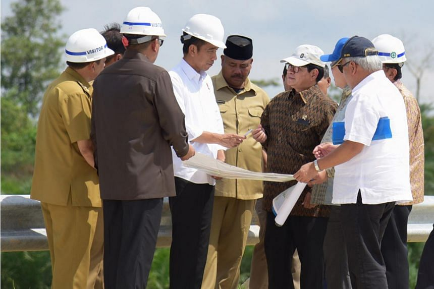 In a photo taken on May 7, 2019, Indonesian President Joko Widodo surveys a possible site for a new capital at Bukit Soeharto in East Kalimantan province.