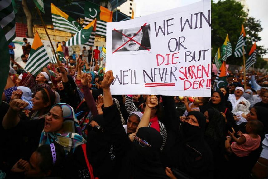 People shout slogans during a protest against India over Kashmir conflicts, in Karachi, Pakistan on Aug 25, 2019.