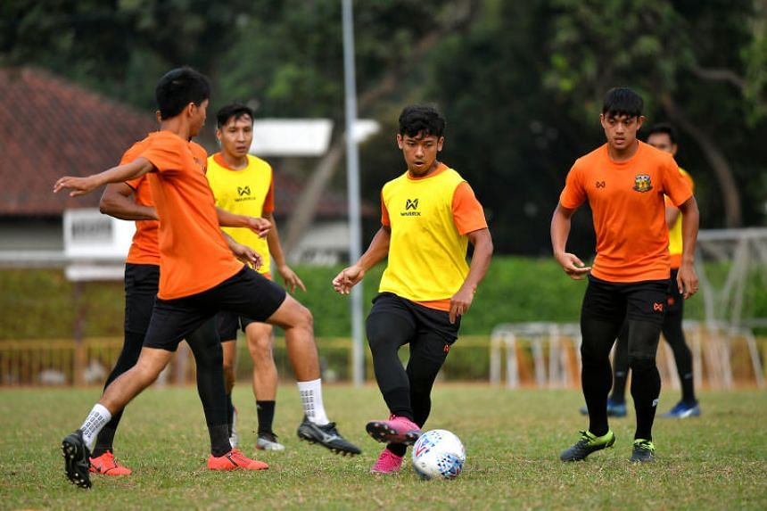 Hougang United's Mahathir Azeman (centre) has spent almost three years on the sidelines as a result of tearing the anterior cruciate ligament in his knee a staggering four times.