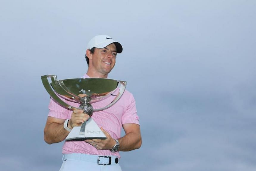 Rory McIlroy celebrates with the FedExCup trophy after winning during the final round of the TOUR Championship at East Lake Golf Club on Aug 25, 2019.