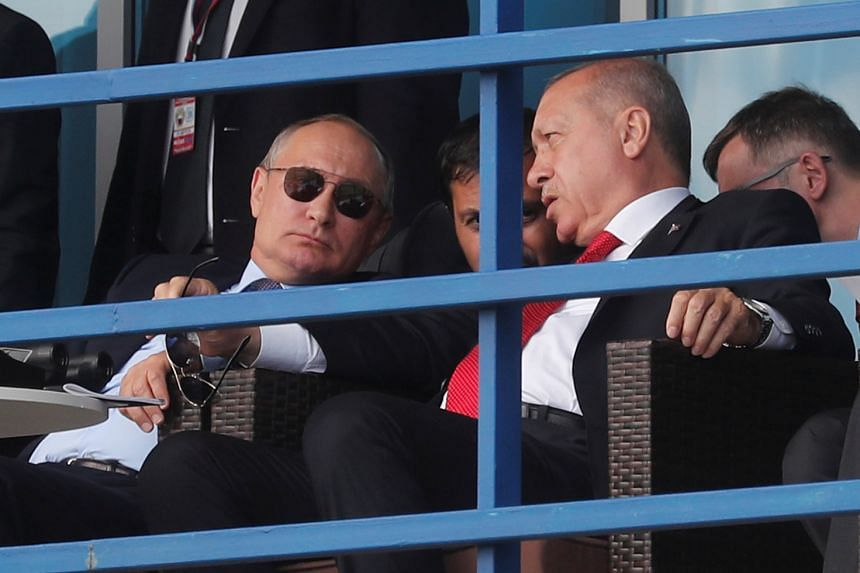 Putin (left) and Erdogan watch demonstration flights during the opening of the air show.