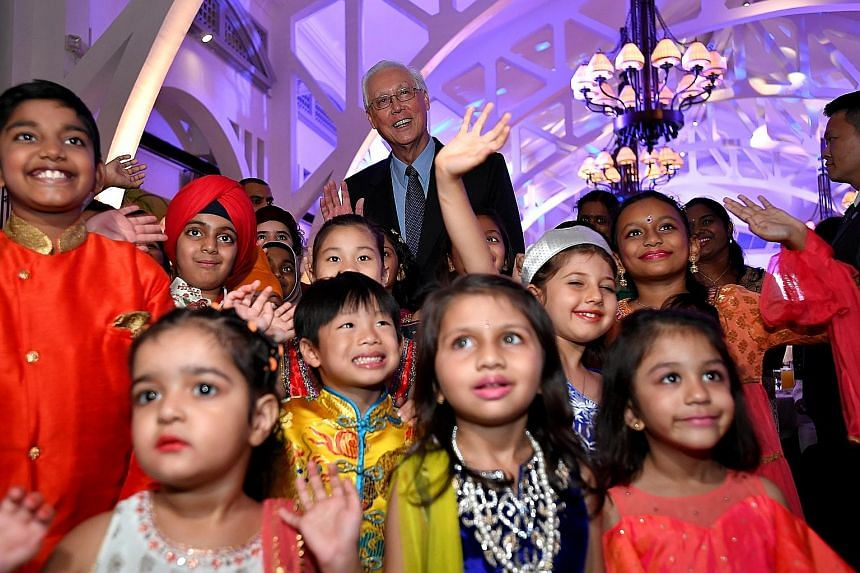 Emeritus Senior Minister Goh Chok Tong, patron of the Inter-Religious Organisation (IRO), with children from the 10 major religions represented by the IRO, at the organisation's 70th anniversary dinner yesterday.
