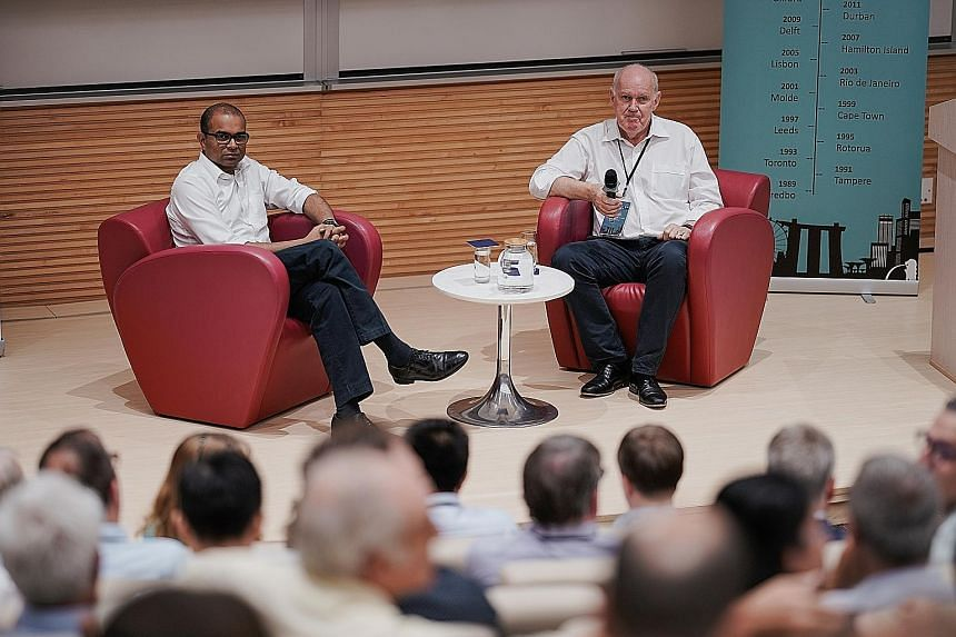 "Senior Minister of State for Transport Janil Puthucheary with Professor David Hensher at the Thredbo Conference in NTU yesterday. Dr Janil said the authorities are taking ""as light a touch of regulation as possible"" to the all-in-one transit apps - t"
