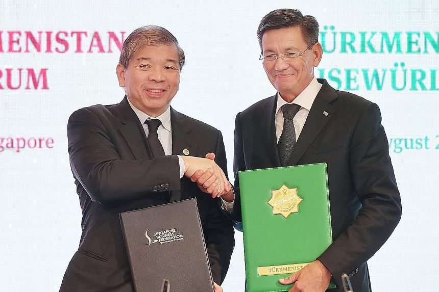 Singapore Business Federation chairman Teo Siong Seng (left) and Turkmenistan Chamber of Commerce and Industry chairman Orazmyrat Gurbannazarov after signing a memorandum of understanding yesterday.