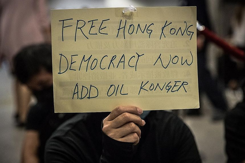 A protester making a point during a sit-in at Revenue Tower in Wan Chai yesterday. PHOTO: EPA-EFE