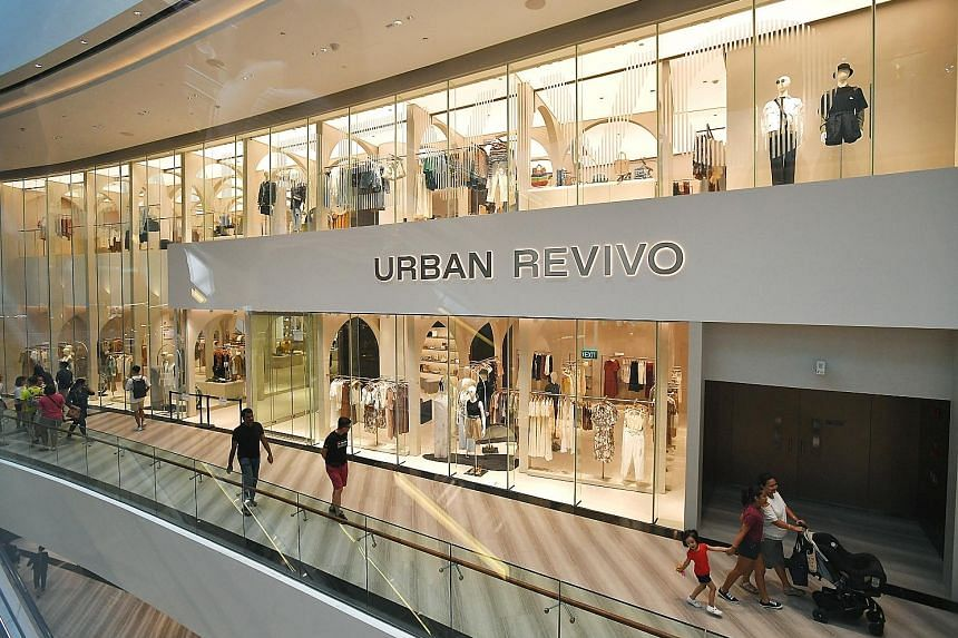 Above: The Urban Revivo store in Jewel Changi Airport where the incident took place last Friday. Left: Full-length mirrors like the one pictured were previously placed in the store. One such mirror was believed to have fallen on the toddler, who late