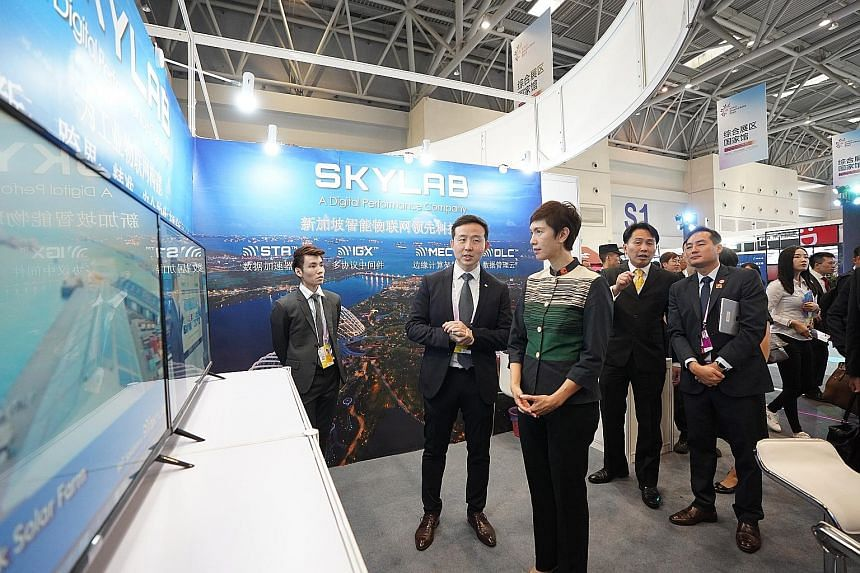 Manpower Minister Josephine Teo and Mr Stephen Ho, managing director of SkyLab Services, at the Singapore Digital pavilion at the Smart China Expo 2019 in Chongqing yesterday. PHOTO: IMDA