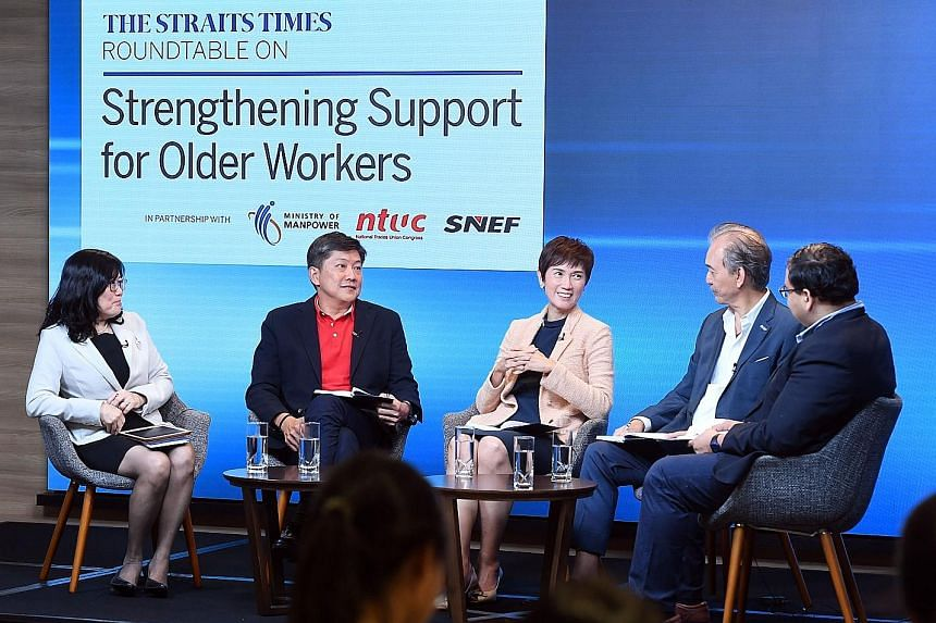 At the round-table discussion last Friday were (from left) Associate Professor Chia Ngee Choon, National Trades Union Congress secretary-general Ng Chee Meng, Manpower Minister Josephine Teo, Singapore National Employers Federation president Robert Y