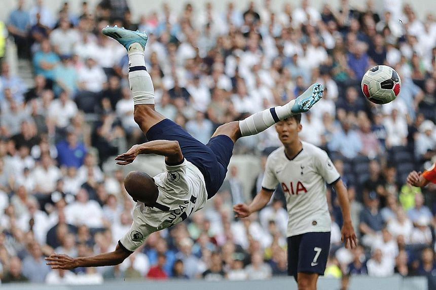 Tottenham forward Lucas Moura trying in vain to score with a bicycle kick during stoppage time of the Premier League match against Newcastle on Sunday. Newcastle won 1-0 to collect their first points of the season. PHOTO: ASSOCIATED PRESS