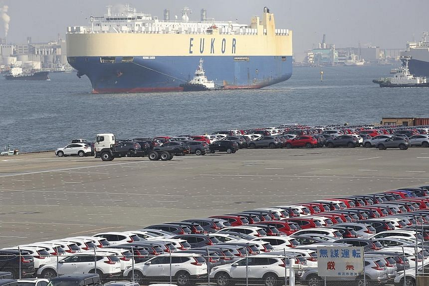 Japanese vehicles for export at a port in Yokohama, near Tokyo, earlier this year. Japanese Prime Minister Shinzo Abe and US President Donald Trump agreed to a deal on Sunday that will see Tokyo reduce levies on US agricultural produce. But Tokyo did