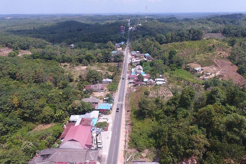 An aerial view of Kutai Kartanegara, one of two regencies in East Kalimantan between which the new capital will be built. PHOTO: AGENCE FRANCE-PRESSE Indonesian President Joko Widodo, flanked by his Vice-President Jusuf Kalla (right) and Agriculture