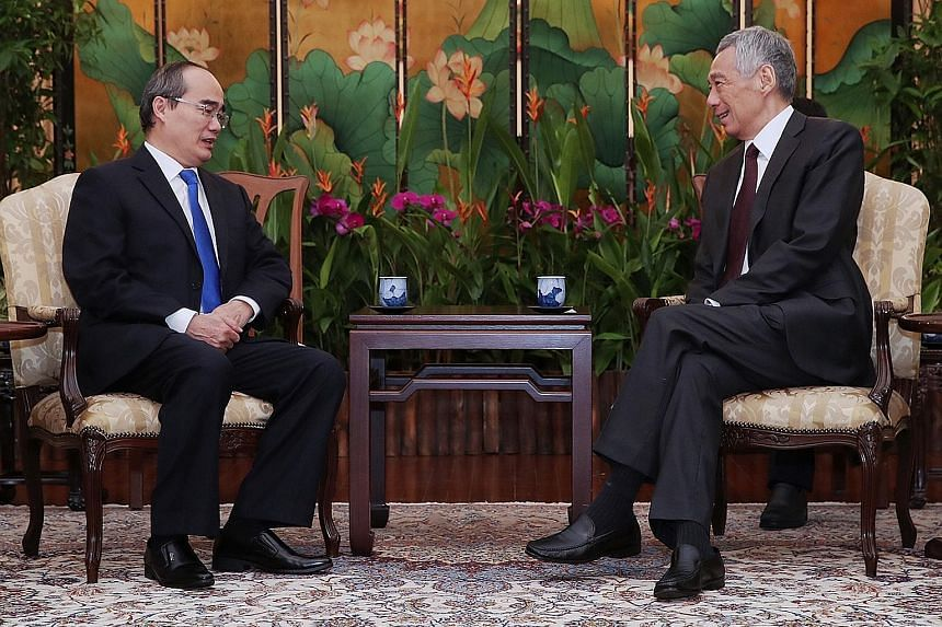 Dr Nguyen Thien Nhan, Secretary of the Party Committee of Ho Chi Minh City, with Prime Minister Lee Hsien Loong at the Istana yesterday. PHOTO: MINISTRY OF COMMUNICATIONS AND INFORMATION