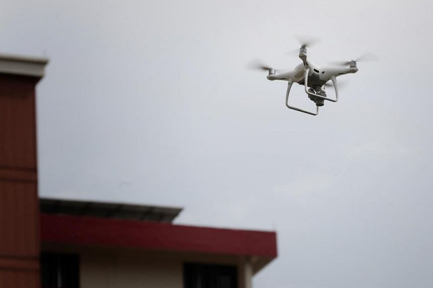 There is currently a ban in Singapore on flying drones within 5km of airports or military airbases, or at altitudes above 61m, without a permit.