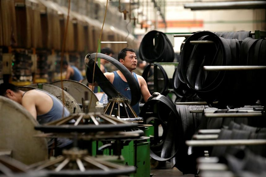 In a photo taken on May 21, 2019, an employee works on the production line of a tyre factory under Tianjin Wanda Tyre Group, in Xingtai, Hebei province, China.