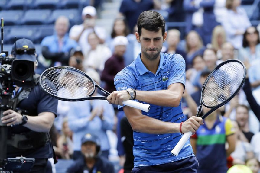Novak Djokovic, of Serbia, dances for fans after beating Roberto Carballes Baena, of Spain, during the first round of the US Open tennis tournament on Aug 26, 2019, in New York.