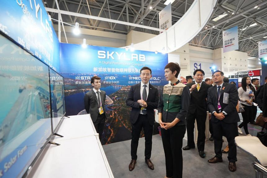 Manpower Minister Josephine Teo and Mr Stephen Ho, managing director of SkyLab Services, at the Singapore Digital pavilion at the Smart China Expo 2019 in Chongqing on Aug 26, 2019.