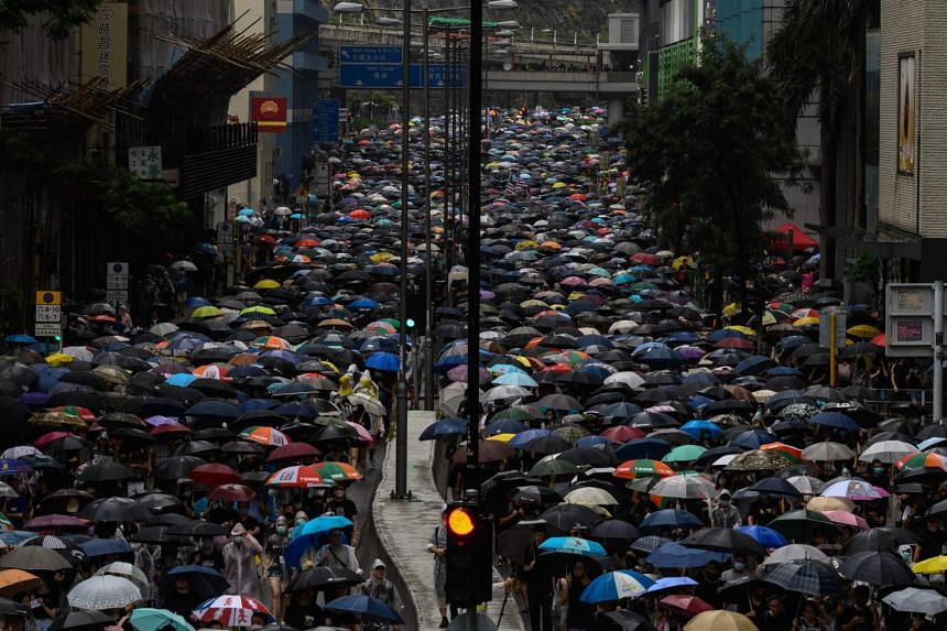 People taking part in a protest in Tsuen Wan district of Hong Kong, on Aug 25, 2019.