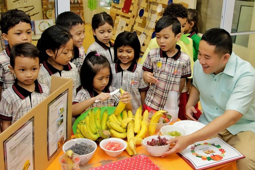 Senior Parliamentary Secretary for Home Affairs and Health Amrin Amin with pre-school children at the PPIS Child Development Centre in Bukit Batok.