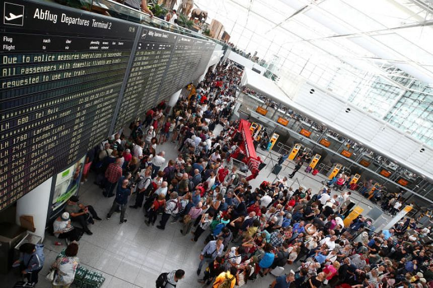 Passengers wait for their flights at Munich Airport's Terminal 2, after it was temporarily closed on Aug 27, 2019.