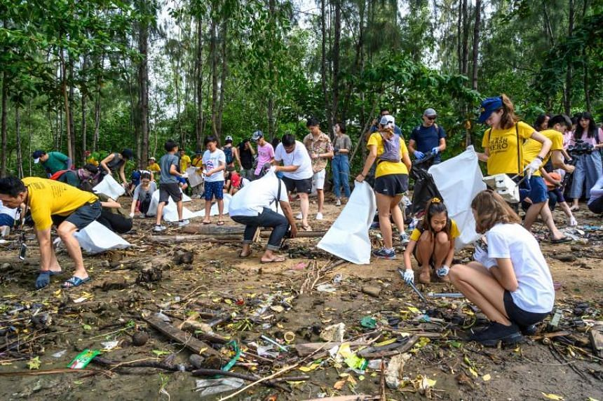 Volunteers collect plastic waste at Khung Bang Kachao Urban Forest and Beach as part of the Trash Hero initiative in Bangkok on Aug 25, 2019.