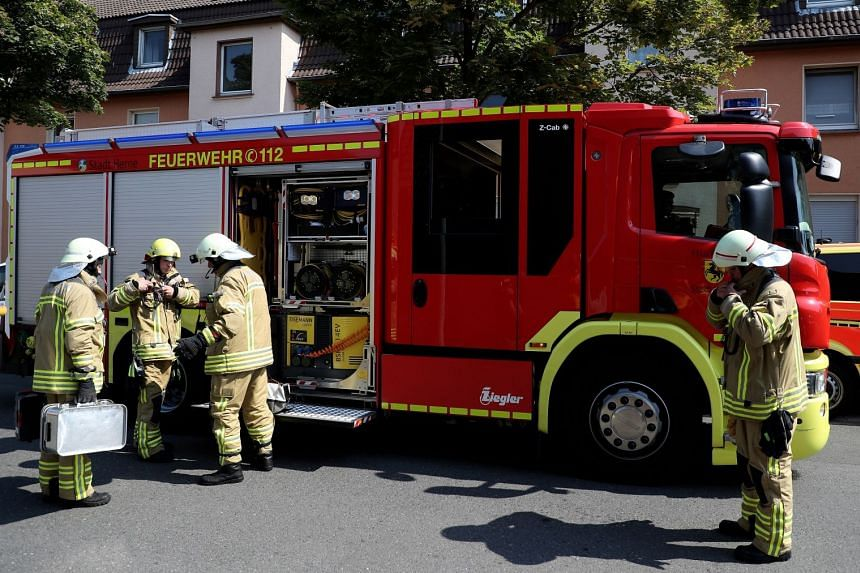 Firefighters arrive to search for a missing cobra in Herne, Germany.