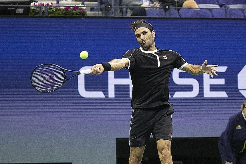 Swiss tennis player Roger Federer playing against India's Sumit Nagal during their men's singles round on Monday, at the US Open tournament.