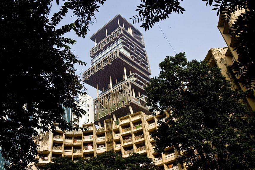 Mr Mukesh Ambani's 27-storey home, Antilia, photographed in 2011. The Mumbai property, which has three helipads, six floors of parking and a series of floating gardens, is one of the world's most expensive private residences.