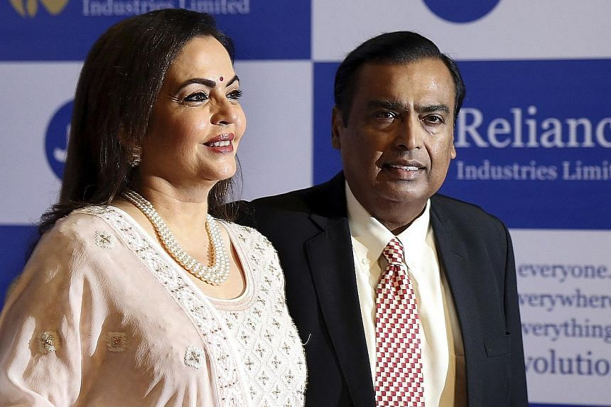 Mr Mukesh Ambani, chairman of Reliance Industries, with his wife Neeta. Mr Ambani's late father started the family's business empire with US$100, and the clan now has a $69 billion fortune. PHOTO: ASSOCIATED PRESS