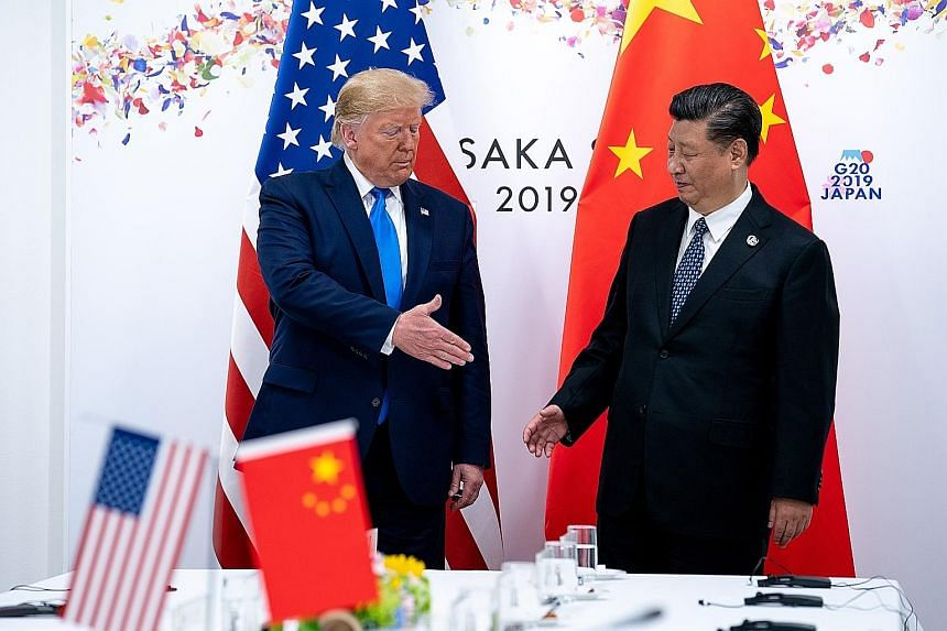 US President Donald Trump and Chinese President Xi Jinping at the G-20 summit in Osaka, Japan, in this file photo taken on June 29. Tensions between the world's two biggest economies have escalated in recent days, after both sides announced new tarif