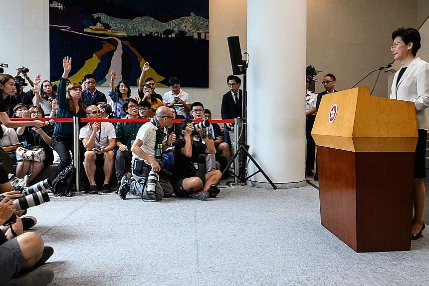 """Chief Executive Carrie Lam at a press conference in Hong Kong yesterday, where she dismissed any suggestion of her resignation, saying a responsible Chief Executive should continue """"to hold the fort and do her utmost to restore law and order in Hong"""