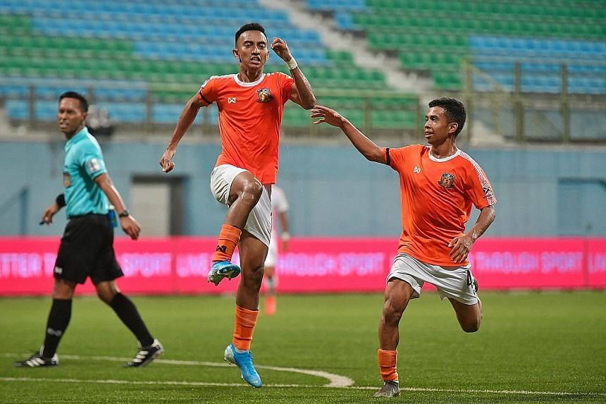 Hougang United striker Faris Ramli (middle) celebrating with Farhan Zulkifli after scoring the equaliser in the 1-1 draw with Albirex Niigata at the Jalan Besar Stadium last night. It was Faris' 13th goal of the season and the point lifted Hougang to top