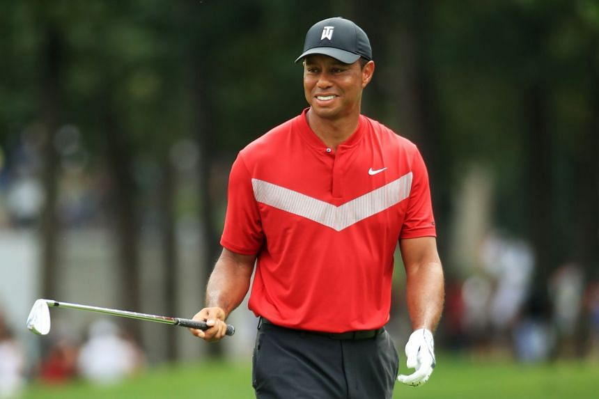 Woods walks on the 18th hole during the final round of the BMW Championship.